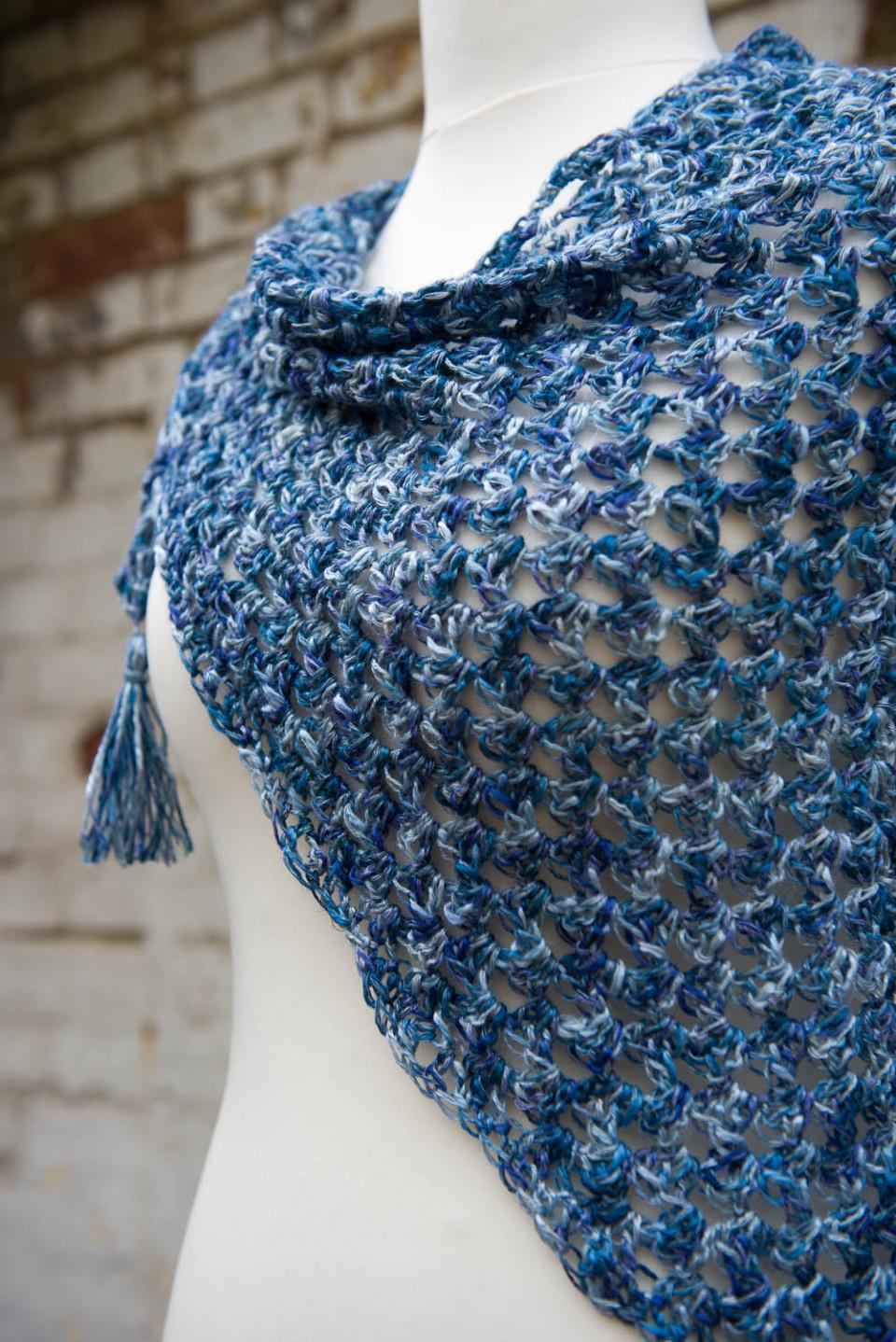 Triangular tassled scarf
