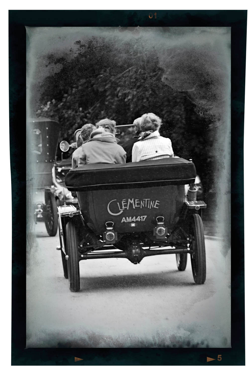A vintage car called Clementine leaving Little Easton Country Fair