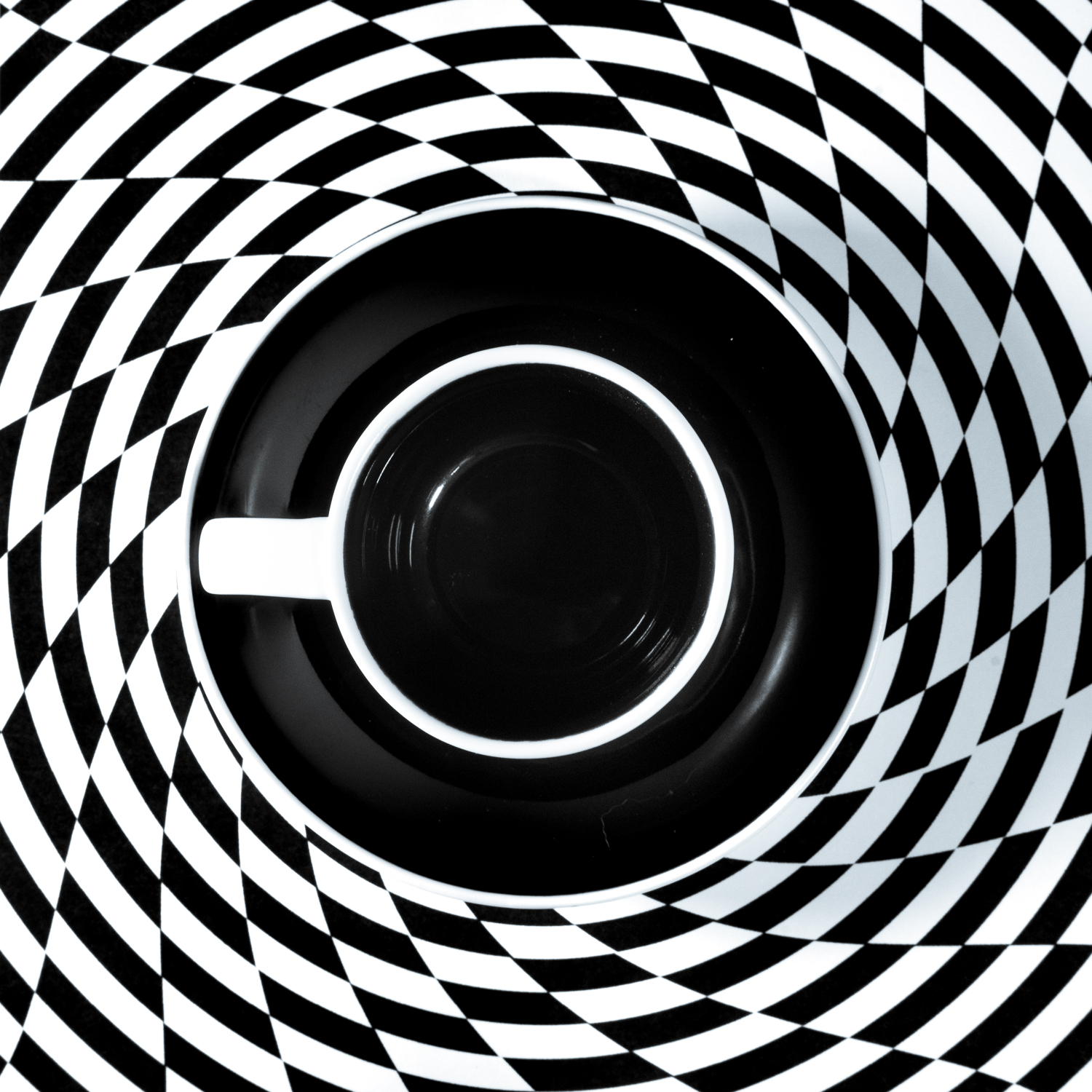 Black and White Unite IX Draining the vortex of coffee